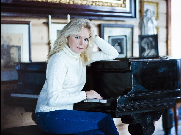 Sitting at Edvard Grieg's piano at his home in Bergen, Troldhaugen.